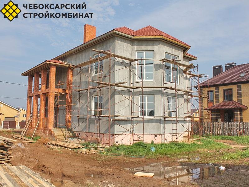 Дом с фасадом из штукатурки